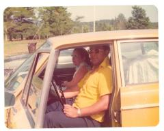 Lillian López and Tony Mondesire in Lillian's car on vacation in Canada