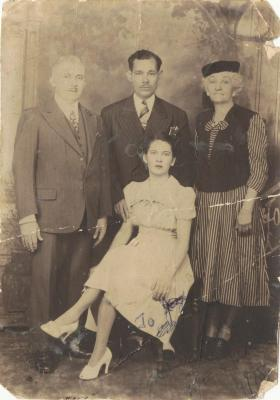 Young Petra Santiago and family