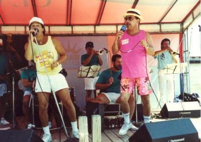 Ray Ramos (in yellow) performing onstage