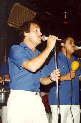 Ray Ramos performing onstage