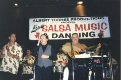 Ray Ramos performing with his band at a salsa music show