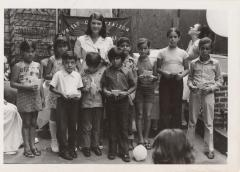 Young lady with a group of children from the United Organization of Suffolk Street