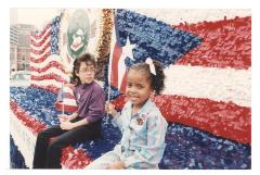 Children on top of the Department of Puerto Rican Community Affairs float at the Puerto Rican Day Parade