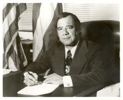 Bobby Capó as Director of the Migration Division