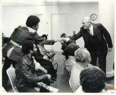 Carlos Romero Barceló shaking hands at Migration Division