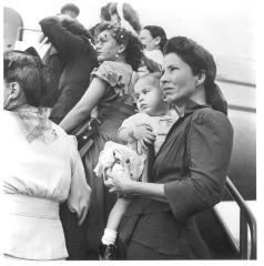Migrant families traveling via plane