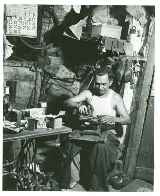 Cobbler repairing a shoe