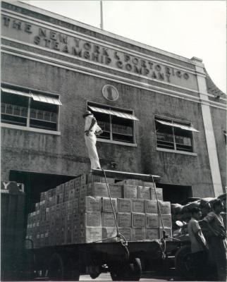 Truckload of Rum Entering a Pier for Export to the U.S.