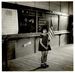 Elementary school student with U.S. flag