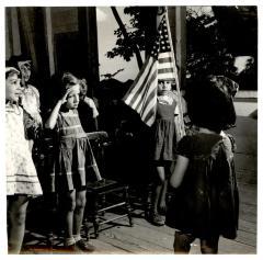 Elementary school students saluting the U.S. flag