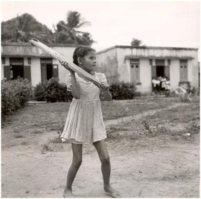 Little girl playing baseball