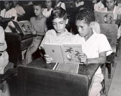Public school students reading a book