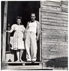 Rural farm workers on the porch of their home