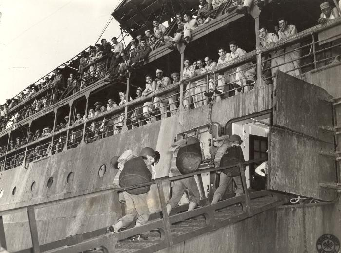 Soldiers boarding a steamship