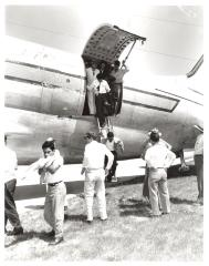 Migrant Workers Exiting Airplane