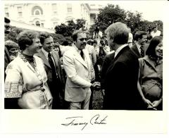 Nelson Diaz shaking hands with Jimmy Carter