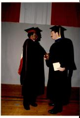 Nelson Diaz receiving diploma at graduation ceremony