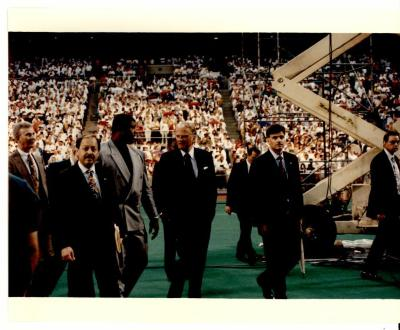 "Nelson Diaz, Reggie White, Billy Graham, and his son during the ""Greater Philadelphia Billy Graham Crusade"""