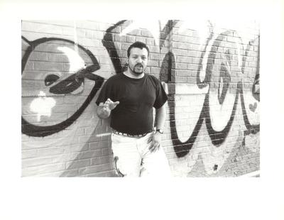 Man in front of graffiti