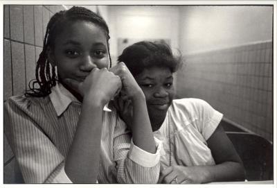 Teenage girls sitting together