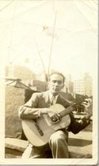 Mario César Romero's father with guitar