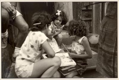 Girls playing together on a stoop