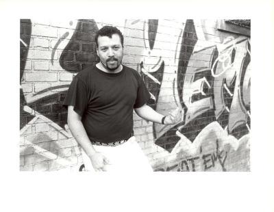 Man in front of graffiti art
