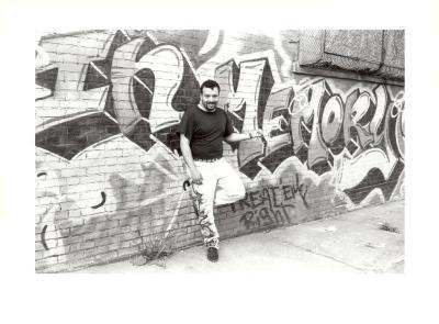 Man in front of In Memorium graffiti art