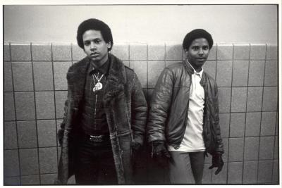 Teen boys in jackets against a wall