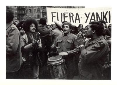 """Protest with sign that reads """"Fuera Yanki"""" (Get Out Yankee)"""
