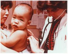 Dr. Helen Rodríguez-Trías performing a checkup on a baby