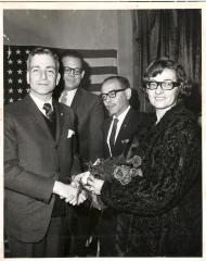 Diana Ramirez receiving flowers