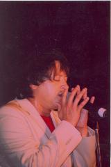 Singer performing onstage