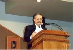 Edgardo Vega Yunqué reading at podium