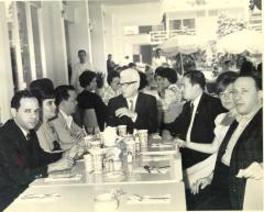 Frank Torres (far left) at a meal with associates