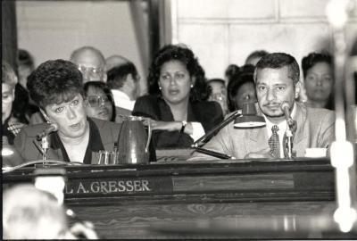Luis O. Reyes at Board meeting with Carol A. Gresser