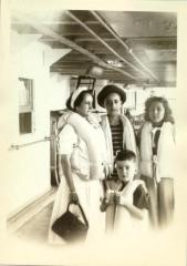 Maria Luisa Ortiz and Torres family pose on steamship deck