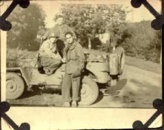 Victor M. Torres in front of a jeep