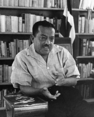 Gilberto Concepción de Gracia in his library