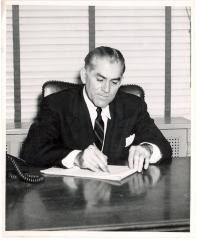 Oscar García Rivera at his desk