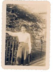 Young Antonia Pantoja leaning on fence