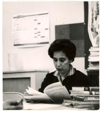 Antonia Pantoja reading a book