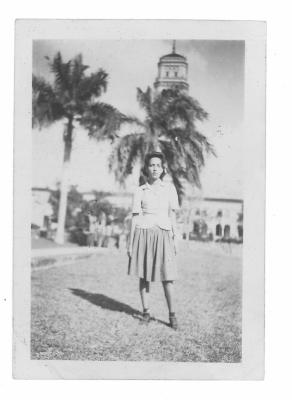 Young Antonia Pantoja with palm trees in background