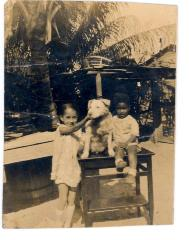 Two children playing with dog