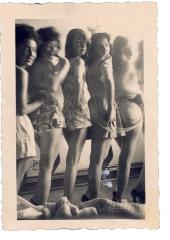 Women posing at beach