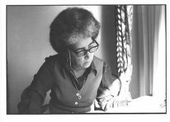 Antonia Pantoja reading a book
