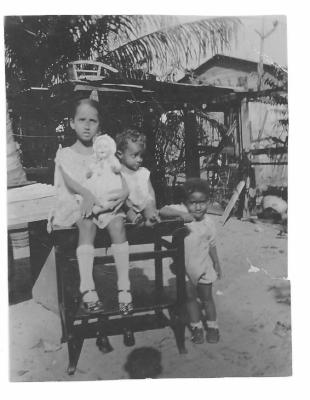 Children playing in a backyard in Puerto Rico