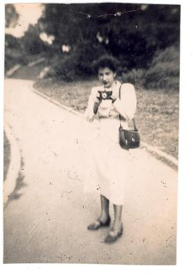 Young Antonia Pantoja holding camera
