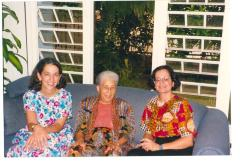 Antonia Pantoja and two other women sitting on a sofa