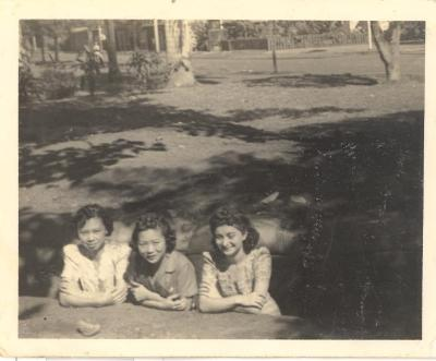 Blase Camacho with two friends in a trench on the school grounds